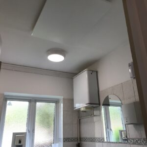 Village hall toilet heating with infrared panels