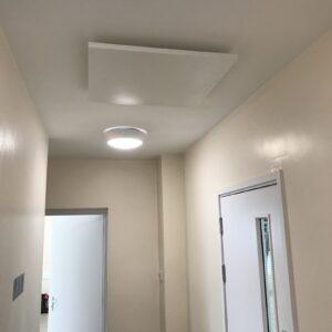 Village hall corridor heating with LAVA Basic DM infrared panels